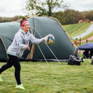 Camping   girl throwing rugby ball