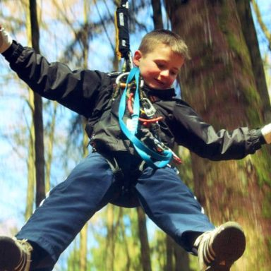 Kid Jumping on Treetop