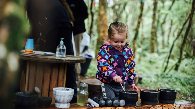 Forest School   girl mixing paints