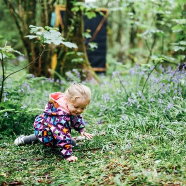 Forest School   girl playing in flowers