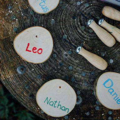 Forest School   kids names drawn on wooden pieces