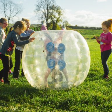 Body Zorbs   girl upside down in Body Zorb